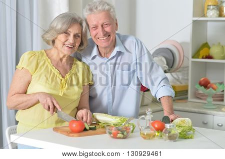Happy senior man and woman  in the kitchen