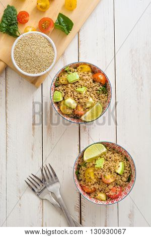 Quinoa salad on a white wooden table