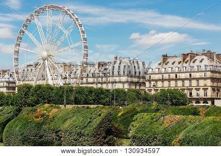 Ferris wheel on the Place de la Concorde from Tuileries Garden in Paris, France.