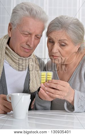 Portrait of an ill senior man and caring wife