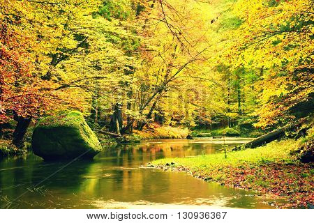Big Boulder Fallen In Autumn River. Colors Of Autumn Mountain River. Colorful Banks With Leaves, Lea