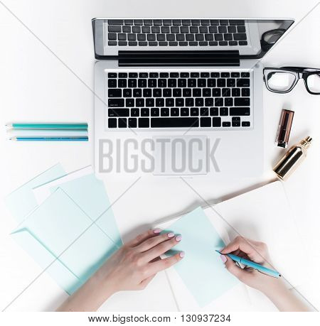 Concept of comfortable female workplaces. Gadgets on the white desk