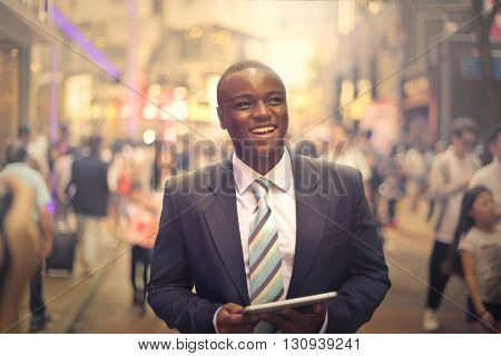 Smiling young businessman in the street