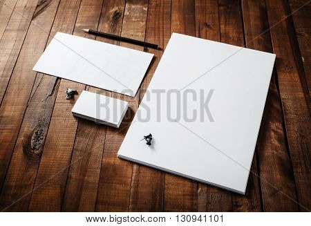 Photo of blank stationery set on wooden table background. Blank stationery template for branding identity for designers.