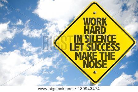 Work Hard in Silence Let Success Make the Noise sign with sky background