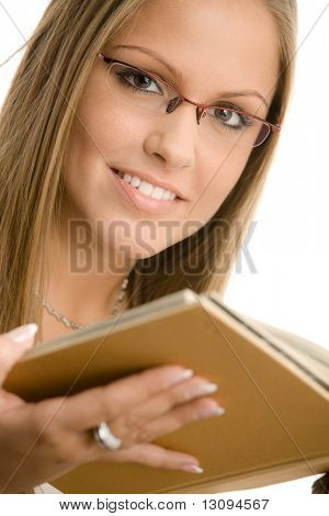 Closeup protrait of beautiful college girl reading book. Isolated on white background.