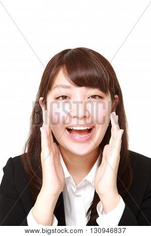 portrait of young Japanese businesswoman shout something on white background