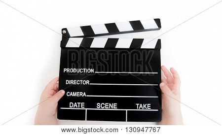 Movie clapper board with baby hands on white concept of first film and movie school