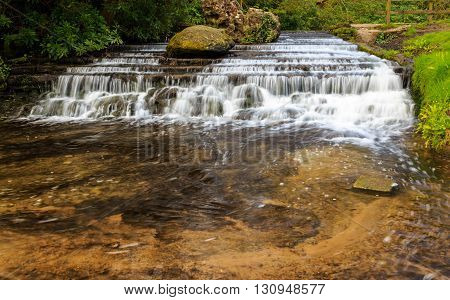 NEWSTEAD ENGLAND - APRIL 30: A man-made stepped waterfall within the grounds of Newstead Abbey. At Newstead Abbey Newstead Nottinghamshire England. On 30th April 2016.