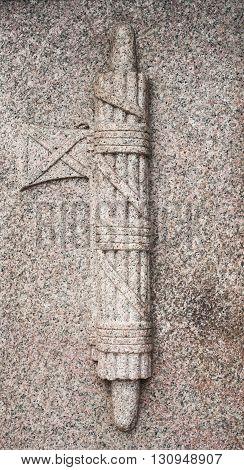 Granite stone fascist symbol bass relief of memory monument detail