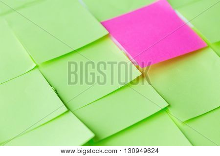 business, information, memo, management and education concept - close up of different color paper stickers