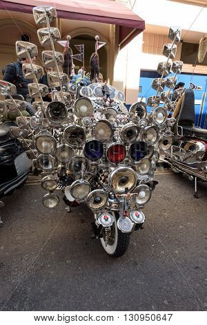 LONDON - ENGLAND 1ST MAY 2016 - A parked Lambretta Scooter covered in mirrors and lights in Soho London during the May the 1st Bank Holiday London to Brighton Mod Rally