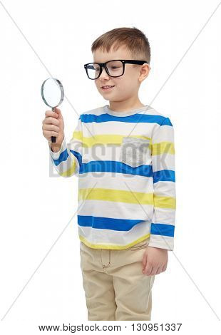 childhood, education, investigation, discovery and people concept - happy little boy in eyeglasses with magnifying glass