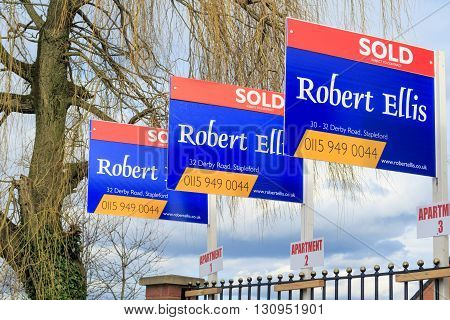 AWSWORTH ENGLAND - FEBRUARY 24: A row of three estate agent 'sold' signs. In Awsworth Nottinghamshire England. On 24th February 2016.