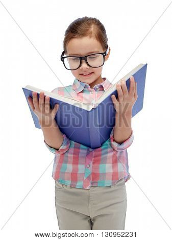 childhood, school, education, vision and people concept - happy little girl in eyeglasses reading book