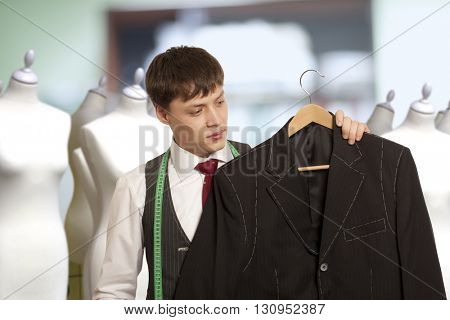 Taylor holds a handmade mans suit