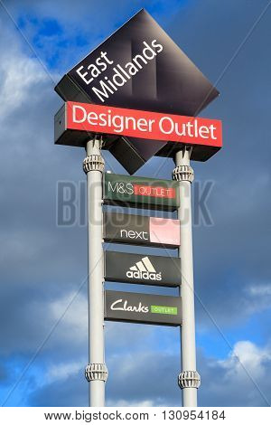 ALFRETON ENGLAND - FEBRUARY 9: The main landmark sign for East Midlands Designer Outlet (McArthur Glenn outlet). In Alfreton Derbyshire England. On 9th February 2016.