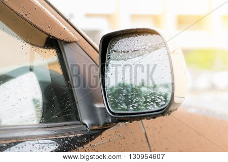 Raindrops on the side mirror of the car after the rain stop.
