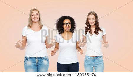 friendship, diverse, body positive and people concept - group of happy different size women in white t-shirts pointing finger to themselves over beige background