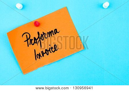 Proforma Invoice Written On Orange Paper Note