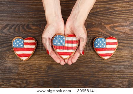 Cookie With American Patriotic Colors In The Hands