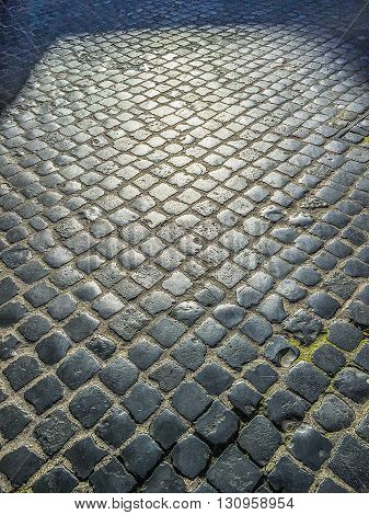 cobblestone pavement in the streets of Rome