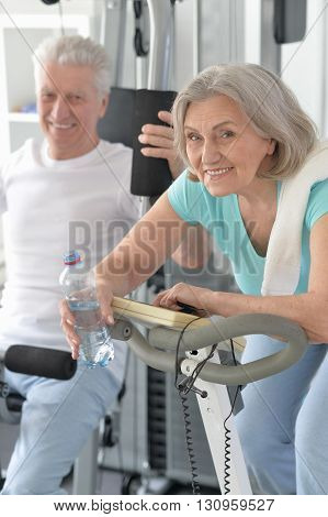 Portrait of a happy sporty senior couple exercising