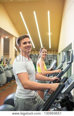 Young people at elliptical indoors