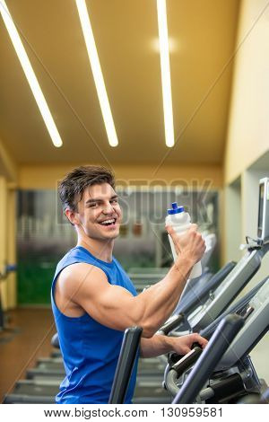 Smiling man with shaker
