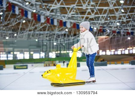 Little child at ice-skating rink