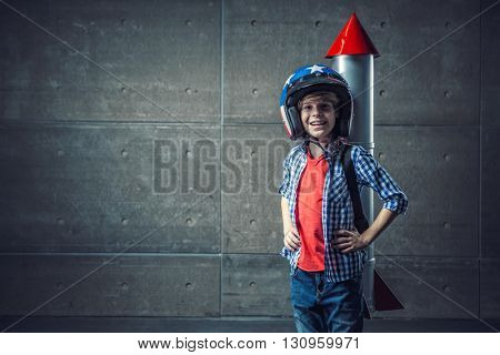 Boy with a rocket and helmet