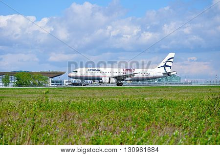 SAINT PETERSBURG RUSSIA - MAY 11 2016. Aegean Airlines Airbus A320 aircraft -registration number SX-DVU - is riding on the runway after arrival at Pulkovo International airport