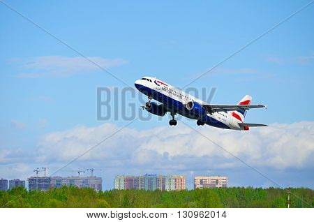 SAINT PETERSBURG RUSSIA - MAY 11 2016. British Airways Airbus A320 aircraft -registration number G-EUUC- is flying in the sky after departure from Pulkovo International airport