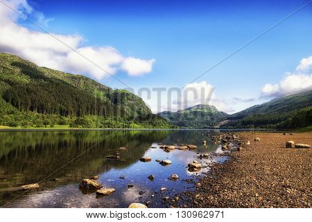 Landscape of mountain reflections on Loch Lubnaig Scotland