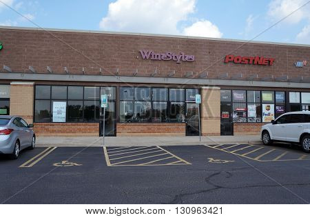 SHOREWOOD, ILLINOIS / UNITED STATES - AUGUST 16, 2015: One may purchase wine at Wine Styles, and ship packages at Post Net, in a strip mall in Shorewood.