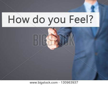 How Do You Feel - Businessman Hand Holding Sign