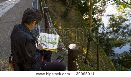 Nara Japan - October 26: woman paints in tha nara park