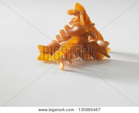 fusilli on the white background