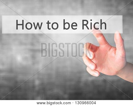 How To Be Rich - Hand Pressing A Button On Blurred Background Concept On Visual Screen.