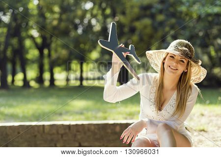 Beautiful attractive young woman having fun daydreaming and enjoying in the park on a sunny summer day
