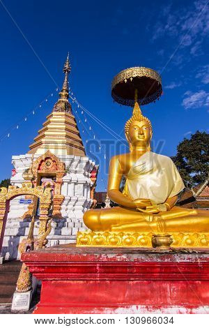 thai golden buddha statue with pagoda , Thailand