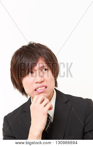 portrait of perplexed businessman on white background