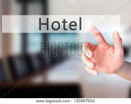 Hotel - Hand Pressing A Button On Blurred Background Concept On Visual Screen.