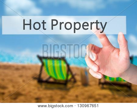 Hot Property  - Hand Pressing A Button On Blurred Background Concept On Visual Screen.