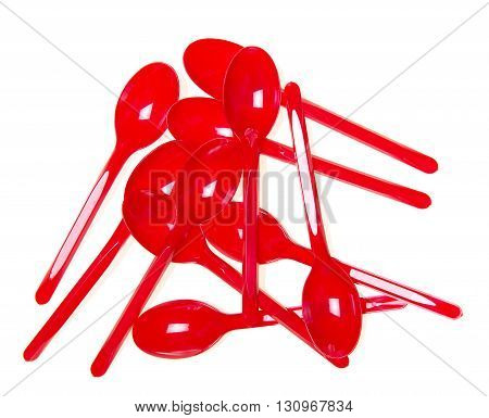 Red plastic spoon close-up isolated on white background.