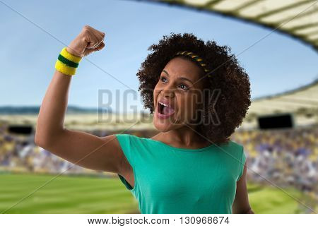 Afro woman celebrating in the stadium
