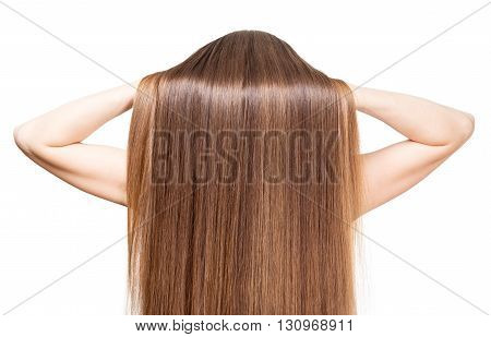 She raises her hands smooth shiny brown hair isolated on white background.