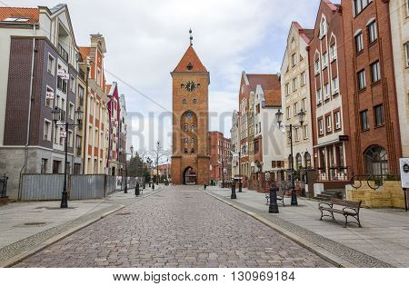 ELBLAG, POLAND - APRIL 8: Old Market Street and the Market Gate on April 8, 2012 in Elblag.
