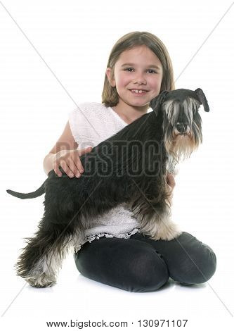 child and  a miniature schnauzer in studio