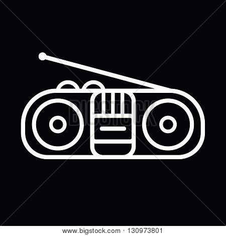 Old cassette player line art vector icon isolated on a black background.